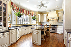 A Kitchen with Hardwood Floors and Granite Counters